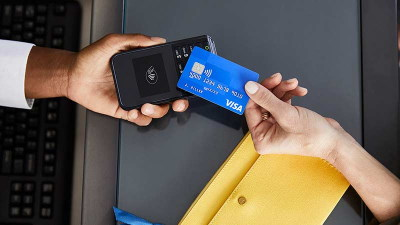 Contactless card being used